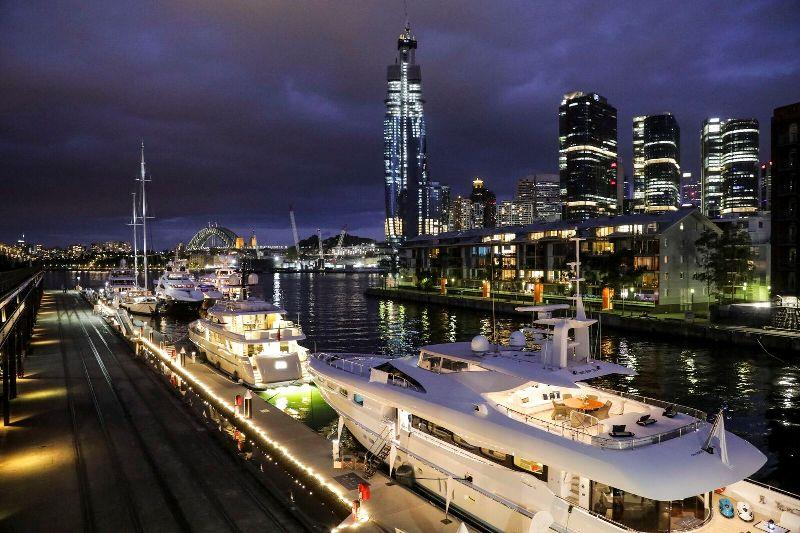 The line up of superyachts looking just as spectacular after sunset. - photo © AIMEX