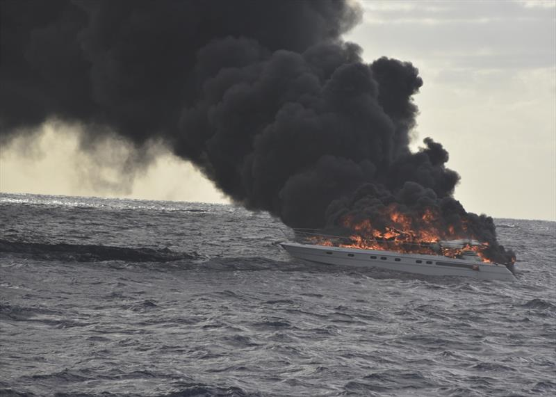 The pleasure craft, Family Time, sits in the water on fire approximately 30 miles east of Miami Beach, Friday, Dec. 7, 2018. The Coast Guard Cutter Robert Yered (WPC-1104) responded to the vessel on fire to assist the survivors. - photo © Petty Officer 2nd Class Jonathan Lally