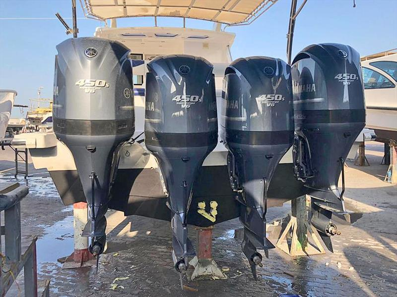 Finalising installation of the four Nizpro Marine 450s outboards on the Al Hareb Marine 56-footer - photo © Al Murzem Tradin