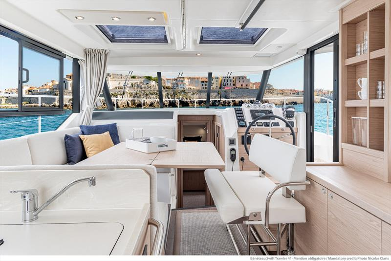 Innovative pilot's chair swings around and down to form part of the dining suite - photo © Beneteau