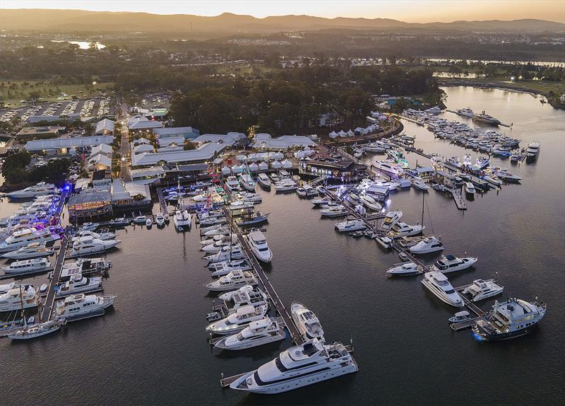 All ablaze - as the sun sets the lights come on at the Maritimo stand at the Sanctuary Cove Festival of Boating - photo © Maritimo