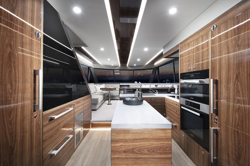 Pantry to the left and fridge to the right, with the great new backward facing stairs behind the black panel - New Maritimo M55 photo copyright Maritimo taken at  and featuring the Power boat class