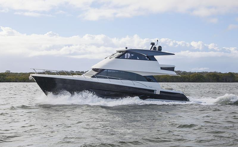 Hull#7 of Maritimo's new M55 series is off to the USA and sports this black paint job, gunwale doors, and also a pair of 1000hp donks to take her well into the mid 30s. - photo © John Curnow