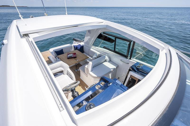 Sliding sunroof, completely open plan spaces, and seats for four facing forward - Beneteau Gran Truismo 36 - photo © Beneteau